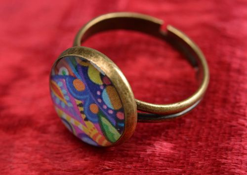 Handmade decoupage jewelry ring in epoxy resin with bright pattern on metal basis - MADEheart.com