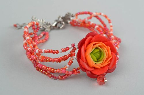 Handmade womens designer beaded wrist bracelet with red polymer clay flower - MADEheart.com