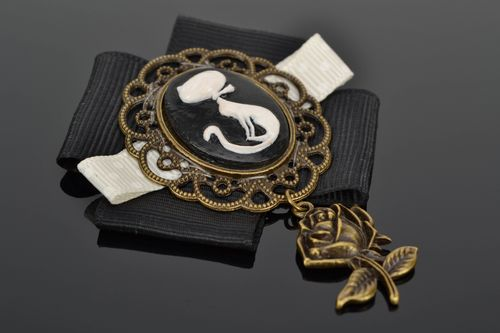 Handmade metal cameo brooch with charm in the shape of rose and ribbons - MADEheart.com