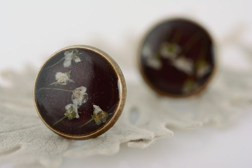 Small flat round dark homemade stud earrings with dried flowers in epoxy resin  - MADEheart.com