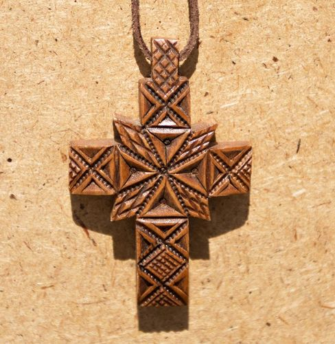 Carved wooden cross with ancient symbolics - MADEheart.com