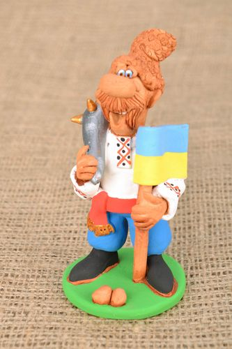 Homemade funny clay statuette Cossack with a Flag and a Saber - MADEheart.com