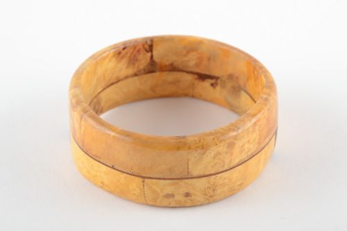 Fashionable handmade wrist bracelet carved of light wood and varnished for women - MADEheart.com