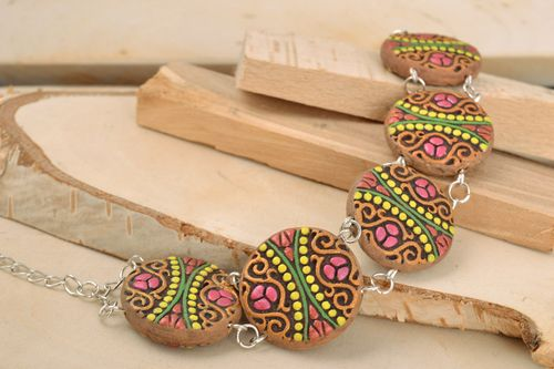 Womens wrist bracelet with brightly painted round ceramic elements handmade - MADEheart.com