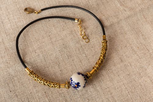 Handmade necklace choker made of brass with porcelain bead on leather lace - MADEheart.com
