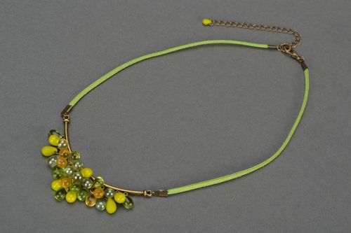 Handmade beautiful necklace made of glass beads on a chamois lace Clusters - MADEheart.com
