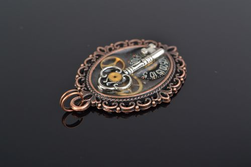 Handmade designer oval metal pendant with key in steampunk style for women - MADEheart.com