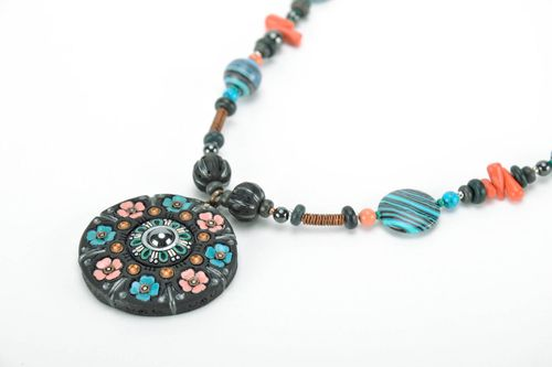 Pendant made of black smoke ceramics with turquoise - MADEheart.com
