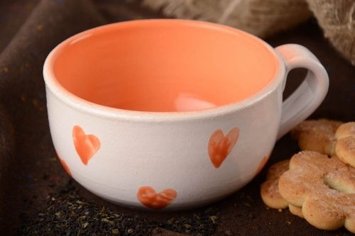Beautiful handmade glazed clay cup of orange color with heart pattern 500 ml - MADEheart.com