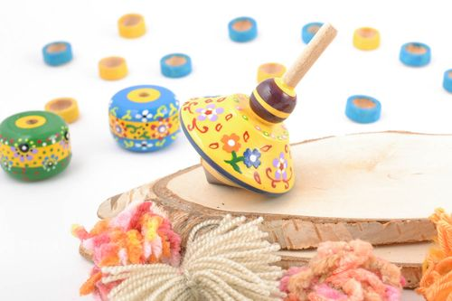 Handmade small painted with eco dyes wooden yellow spinning top toy for kids - MADEheart.com