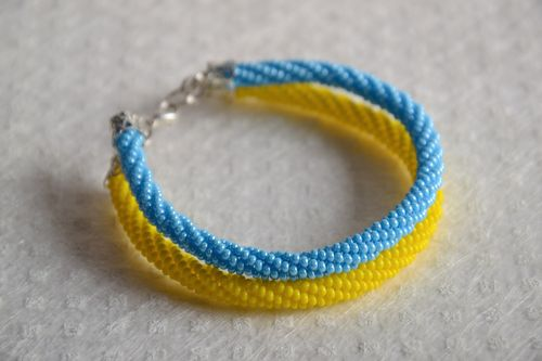 Handmade designer double cord bracelet made of Czech beads yellow with blue - MADEheart.com