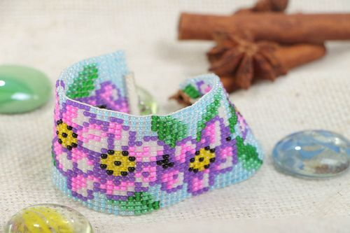 Handmade wide wrist bracelet woven of blue and violet beads with floral motives  - MADEheart.com