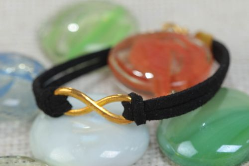 Beautiful festive handmade woven suede cord bracelet of black color with charm - MADEheart.com