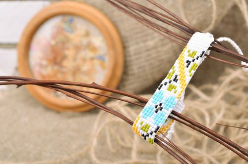 Handmade womens woven bead bracelet with ties White with Flowers - MADEheart.com