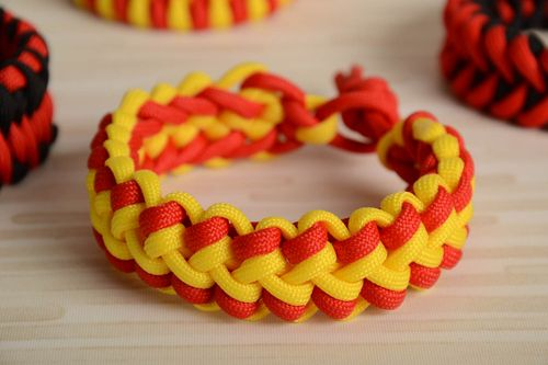 Red and yellow handmade wrist bracelet woven of American paracord - MADEheart.com