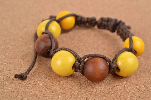 Handcrafted cotton bracelet with insetted handmade wooden beads  - MADEheart.com