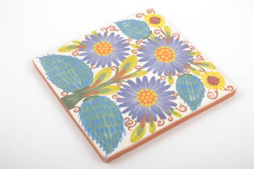 Handmade decorative ceramic tile with floral ornament painted with engobes - MADEheart.com