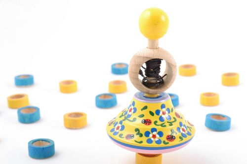 Beautiful painted wooden spinning top with ring and string eco toy for children - MADEheart.com