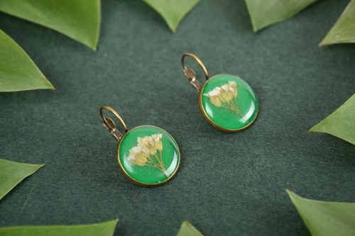 Homemade round green epoxy resin earrings with beautiful flowers inside - MADEheart.com