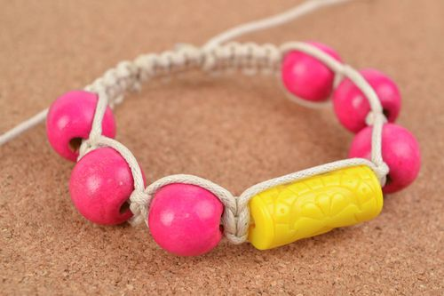 Handmade bracelet made of cotton cord with large wood beads bright acessory - MADEheart.com