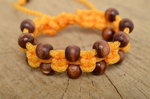 Macrame polyester cord bracelet of yellow color with wooden beads - MADEheart.com