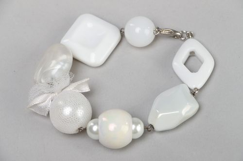 Handmade wrist bracelet with white plastic beads of different shapes and sizes  - MADEheart.com