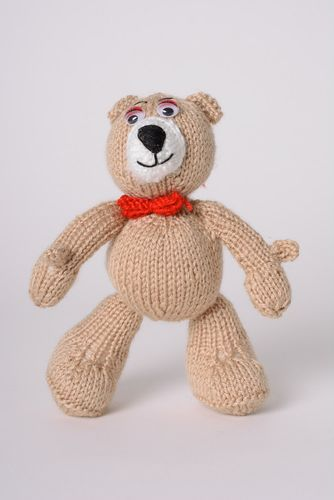 Nice homemade knit soft toy bear of beige color with bow - MADEheart.com