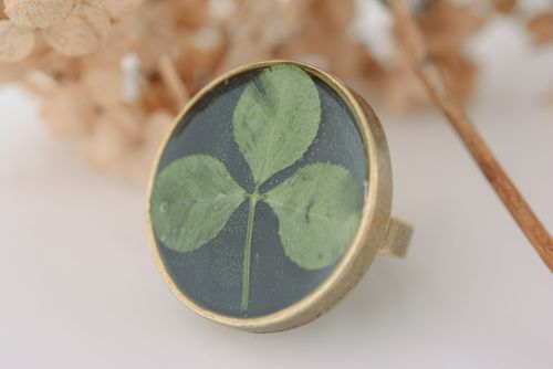 Handmade black round ring on metal basis with clover in epoxy resin for women - MADEheart.com