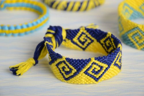 Handmade wide friendship wrist bracelet woven of yellow and blue embroidery floss - MADEheart.com