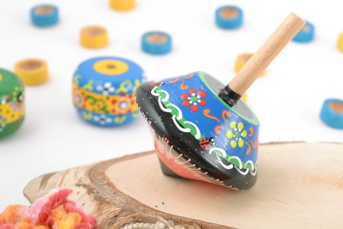 Handmade small blue wooden spinning top toy painted with eco dyes for children - MADEheart.com