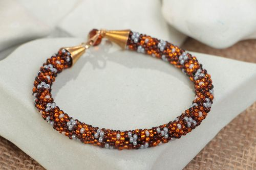 Handmade fashionable beaded cord womens wrist bracelet in brown color palette - MADEheart.com