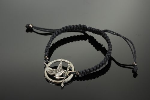 Handmade black friendship wrist bracelet woven of cord with metal charm Mokingjay - MADEheart.com