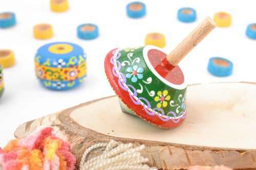 Childrens handmade wooden spinning top toy painted with eco dyes - MADEheart.com