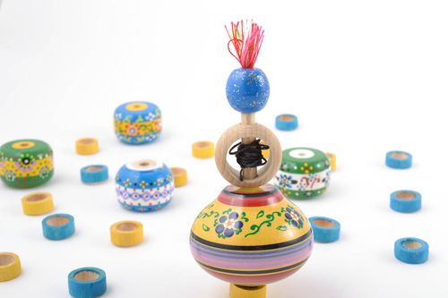 Small funny handmade painted wooden smart toy spinning top for children - MADEheart.com